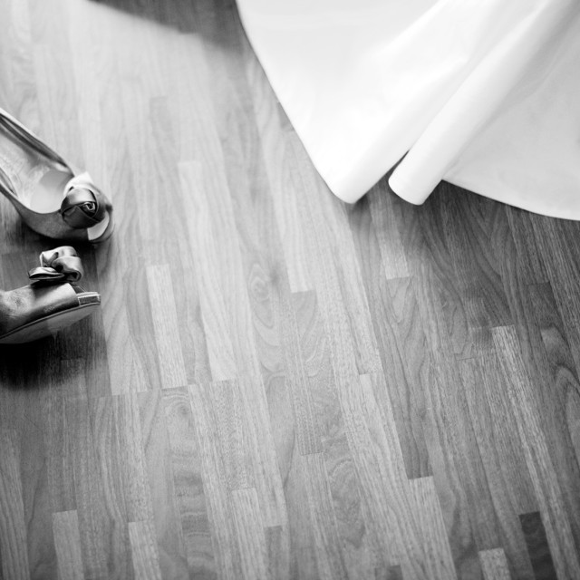 """""""White bridal shoes of bride on floor with dress in bedroom still life marriage photo"""" stock image"""