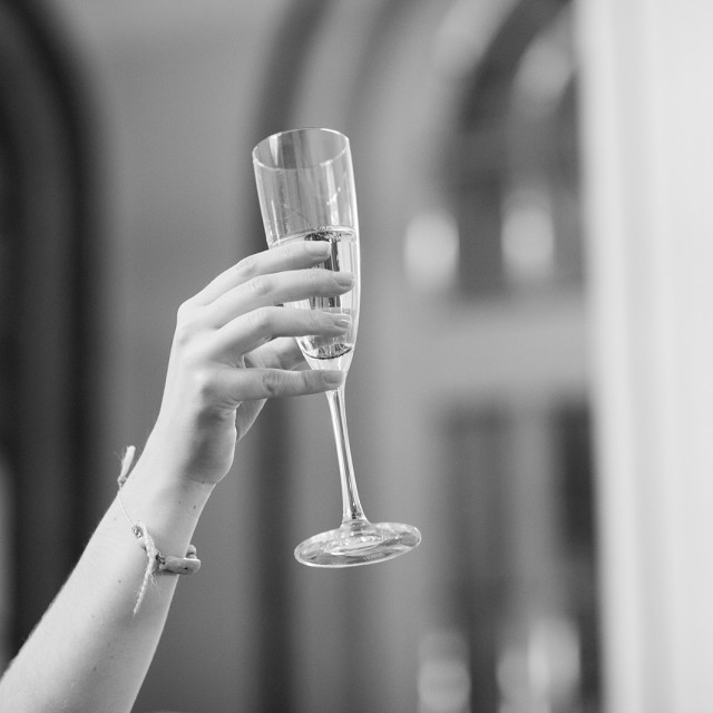 """""""Wedding guest holding champagne sparkling wine glass"""" stock image"""