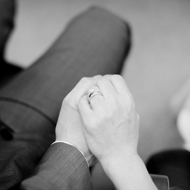 """""""Bridegroom and bride in wedding holding hands in marriage ceremony black and white"""" stock image"""