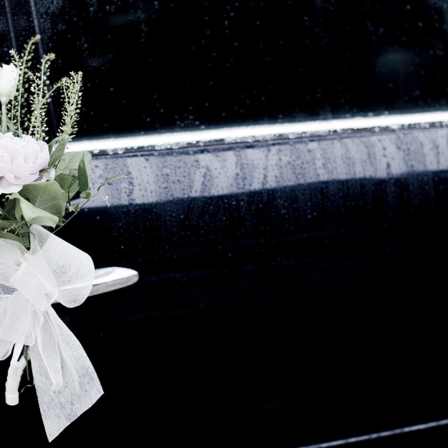 """""""White bridal lace bow and flower rose bouquet tied to wedding limousine classic car still life marriage photo"""" stock image"""
