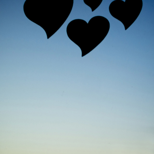 """""""Four love hearts in silhouette with sunset sky background stock photo image"""" stock image"""