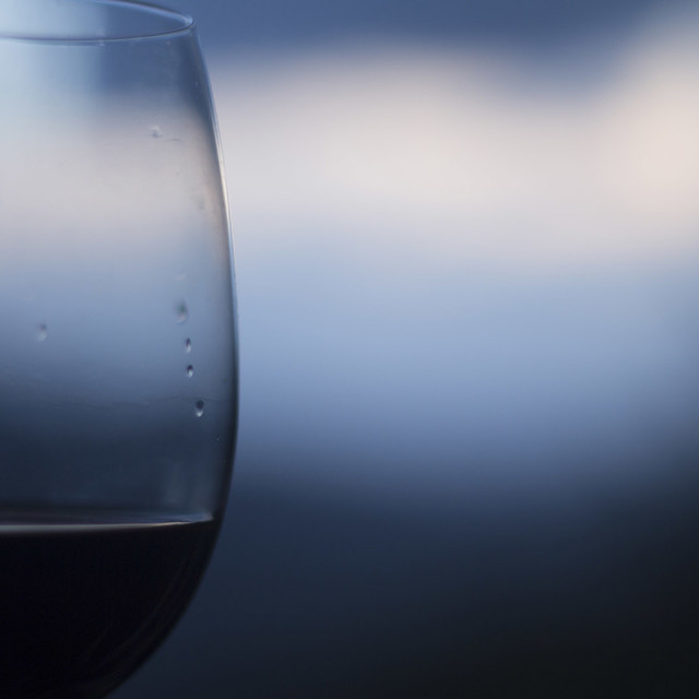 """""""Closeup macro glass of red wine set against blue sky close-up photo"""" stock image"""