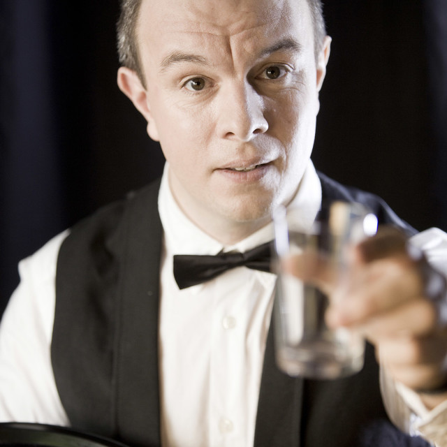 """""""Waiter wearing tray in bowtie holding glass Model released self portrait"""" stock image"""