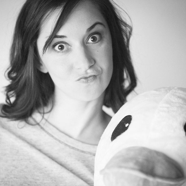 """""""Model released Studio shot portrait of young woman with cuddly toy duck Photo Stock Image"""" stock image"""