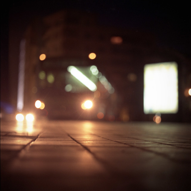 """""""Bus in city at night with motion blur square medium format Hasselblad photo"""" stock image"""