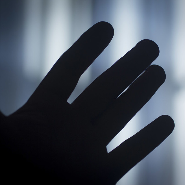 """""""Fingers of hand of man at dusk in room in blue Photographer Stock Image"""" stock image"""