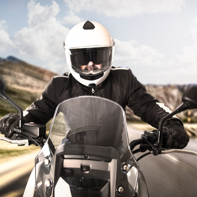 """Biker on the road"" stock image"