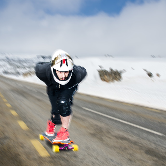 """Downhill skateboarder in action"" stock image"