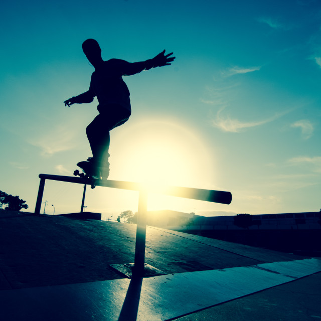 """Skateboarder silhouette on a grind"" stock image"