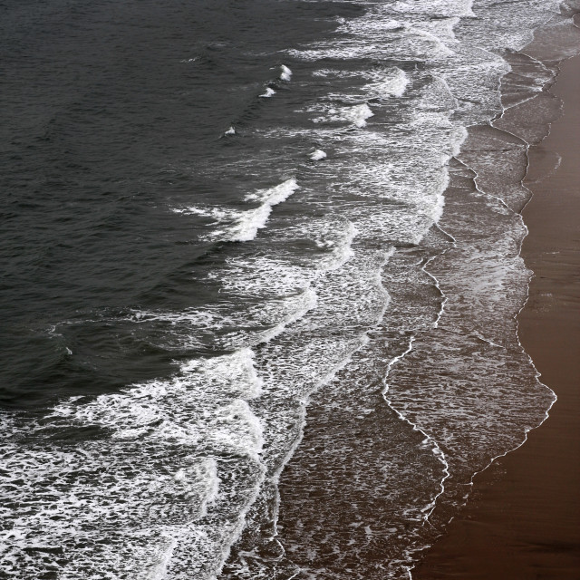"""""""Waves breaking on a sandy beach"""" stock image"""