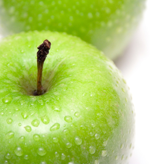 """Two Green Apples with Raindrops"" stock image"