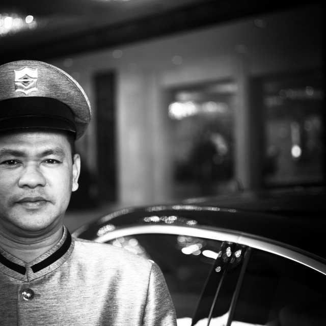 """Parking attendant outside luxury 5 star GL hotel Bangkok Thailand"" stock image"
