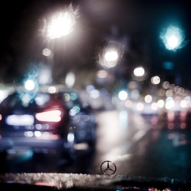 """Mercedes luxury saloon car in wedding driving at night bokeh"" stock image"
