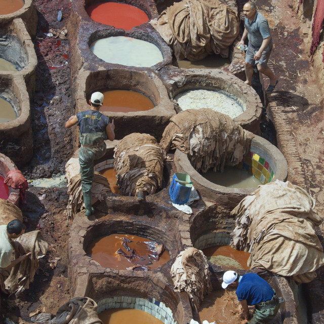 """Men at work in Tannery"" stock image"