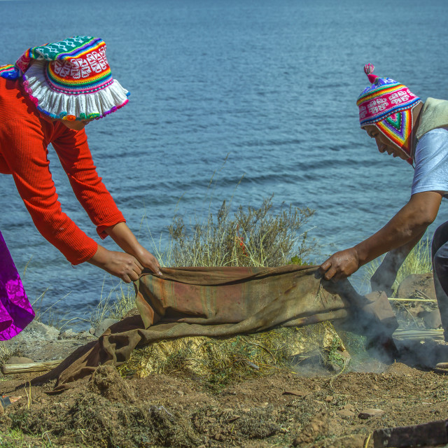 """Cooking a Pachamanca"" stock image"