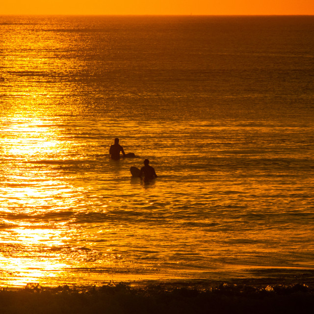 """Sunset surfers.."" stock image"