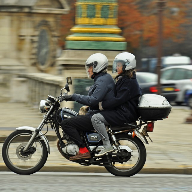 """Couple on a motorbike"" stock image"