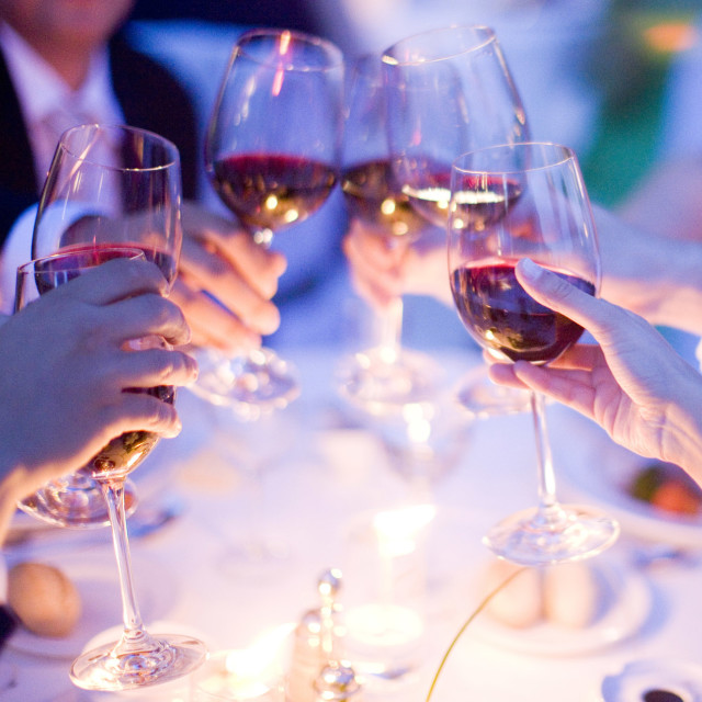 """""""Wedding guests marriage reception party red wine glasses saying cheers"""" stock image"""