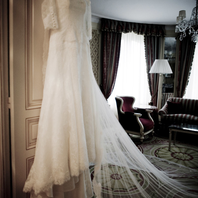 """White wedding marriage dress of bride hanging bedroom Ritz hotel"" stock image"