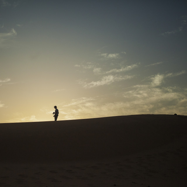 """Silhouette in the sahara"" stock image"