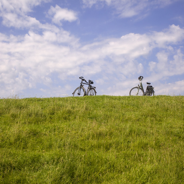 """Two bikes on a dike in the Netherlands"" stock image"