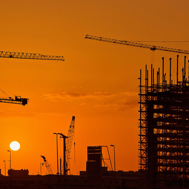 """Sundown, cranes and scaffolding"" stock image"