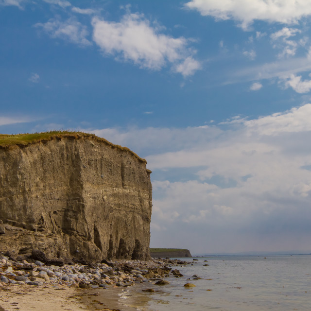 """""""Beach with cliff"""" stock image"""