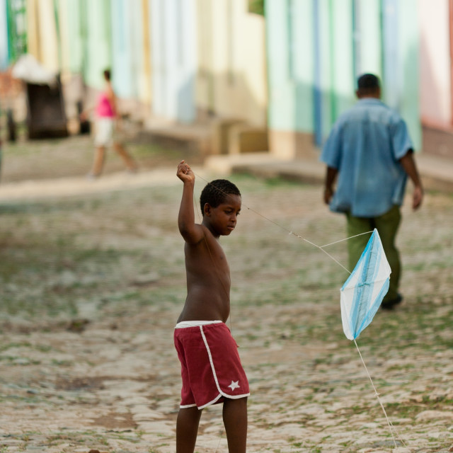 """Child playing with kite in Cuba"" stock image"