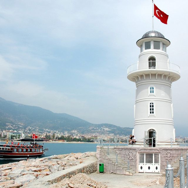 """""""Turkish Lighthouse and boat at harbour"""" stock image"""