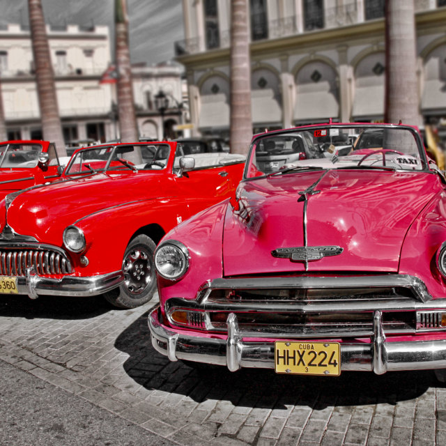 """Line up of convertible taxi's"" stock image"
