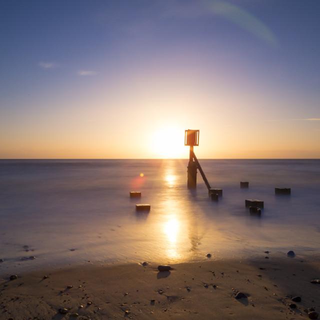 """Dawn on a Still Ocean"" stock image"