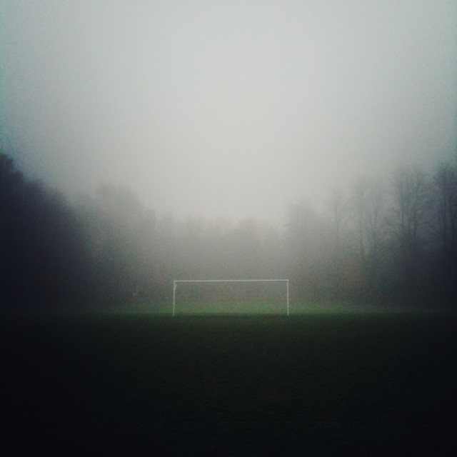 """""""Football pitch in the fog"""" stock image"""