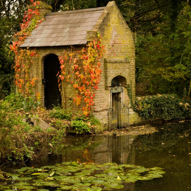 """Brick House on Pond"" stock image"