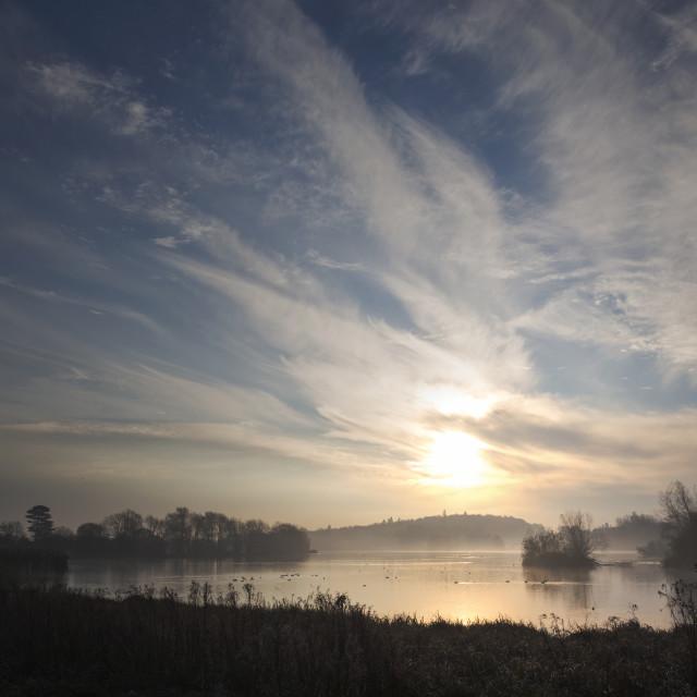 """""""Early morning sunrise on the lake"""" stock image"""