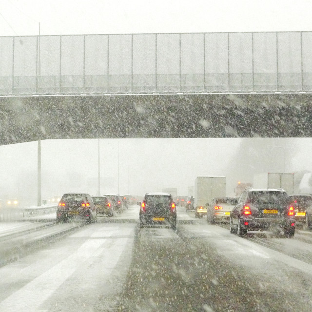 """Highway traffic in a snow storm"" stock image"
