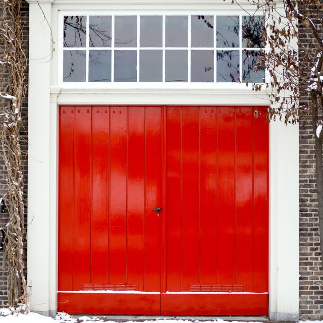 """Bright red garage doors"" stock image"