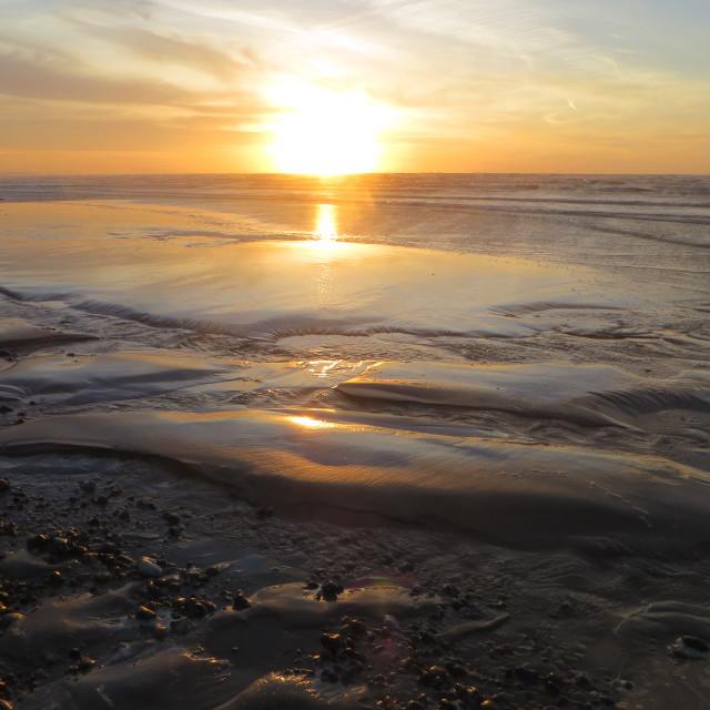 """""""Tuesday morning sunrise on Shoreham beach"""" stock image"""