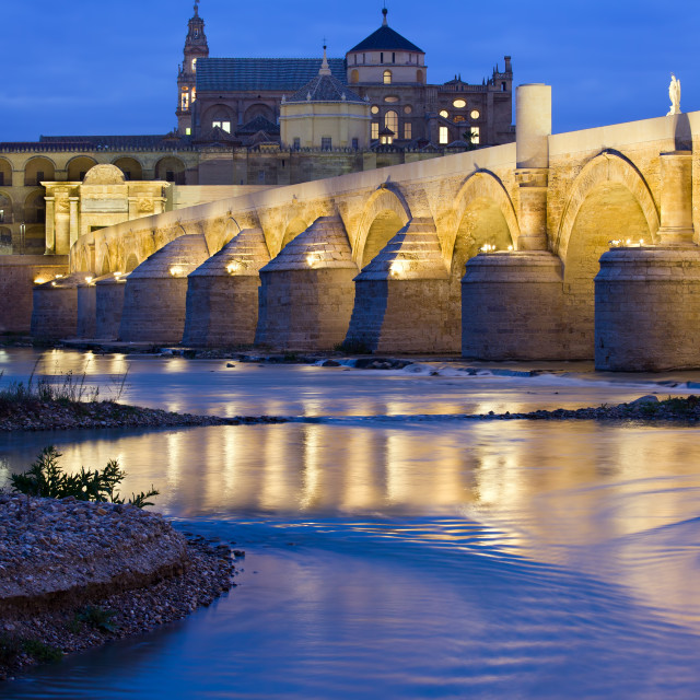 """Roman Bridge on Guadalquivir River at Dawn"" stock image"