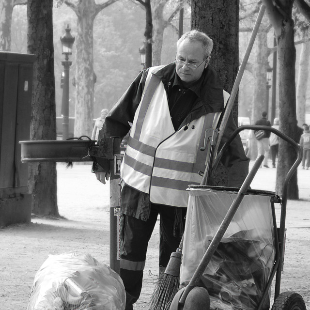 """A street cleaner on the Avenue des Champs-Élysées"" stock image"