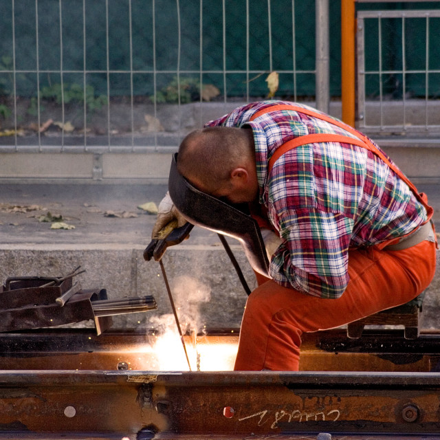 """Worker Fixing Rails"" stock image"
