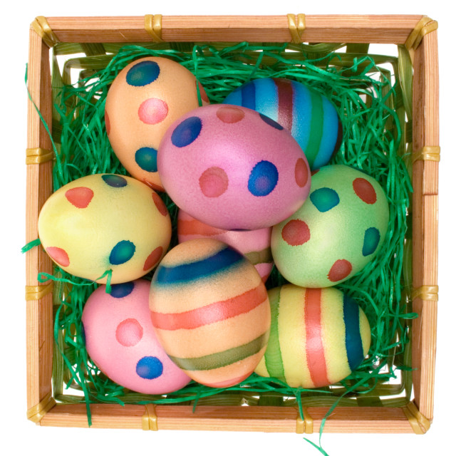 """Colored Eggs in a Wooden Basket"" stock image"