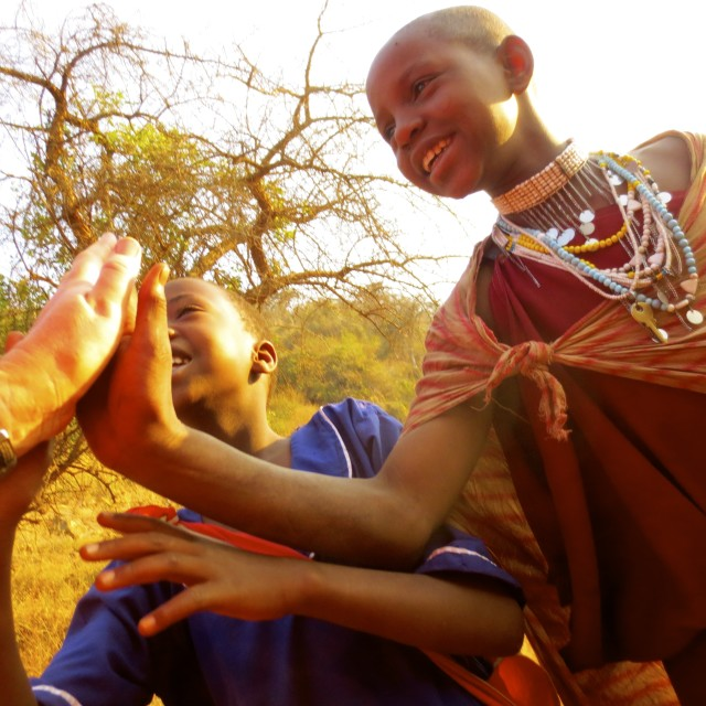 """High five with Maasai children"" stock image"