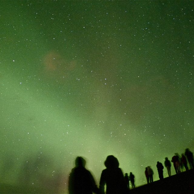 """Young Couple watching the Northern Lights"" stock image"