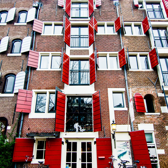 """Red Shuttered Canal Houses in Amsterdam"" stock image"