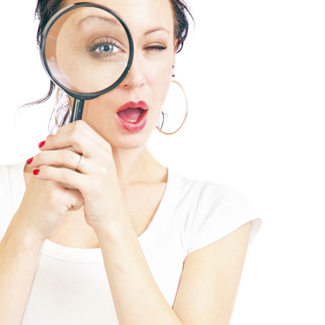 """""""Pretty Young Woman With Magnifying Glass"""" stock image"""