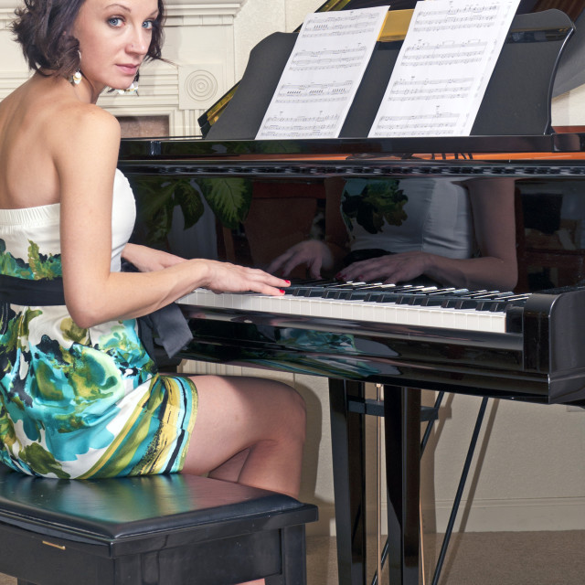 """""""Pretty Brunette Piano Player"""" stock image"""