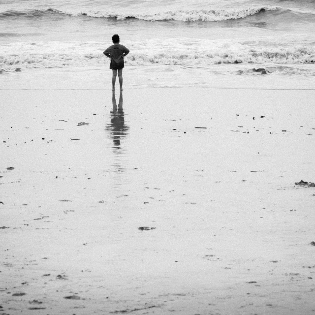 """Lone Boy Standing in the Beach"" stock image"