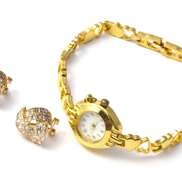 """""""golden wrist watch and earrings"""" stock image"""