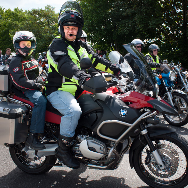 """Pillion ride with Dad"" stock image"