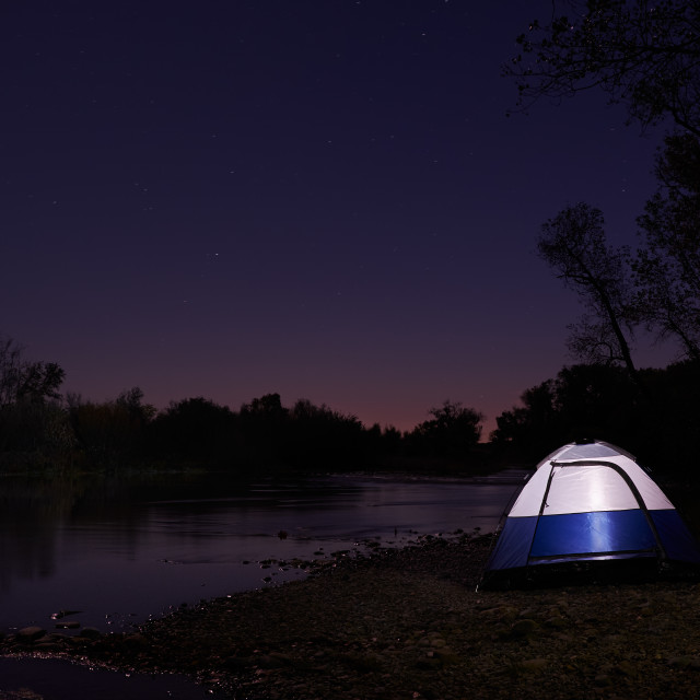"""""""Tent on the Edge of A River at Night"""" stock image"""